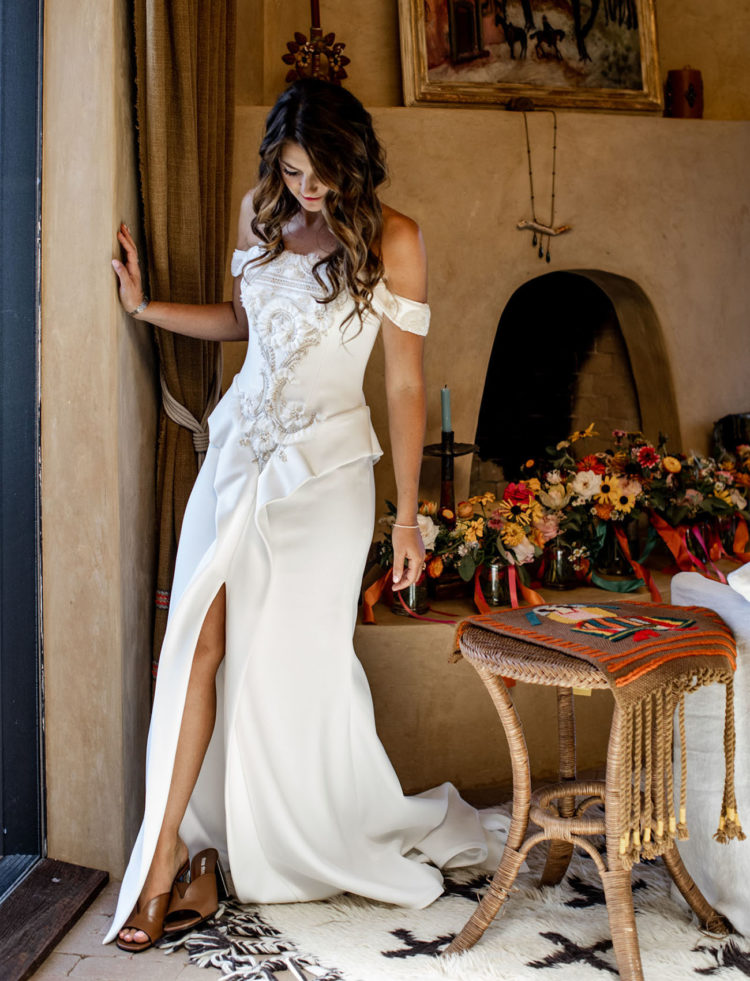 The bride was wearing a fantastic off the shoulder wedding dress with appliques and embroidery and mules
