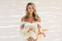 03 The bride was wearing an off the shoulder mermaid wedding dress and carrying a creamy and rust bouquet