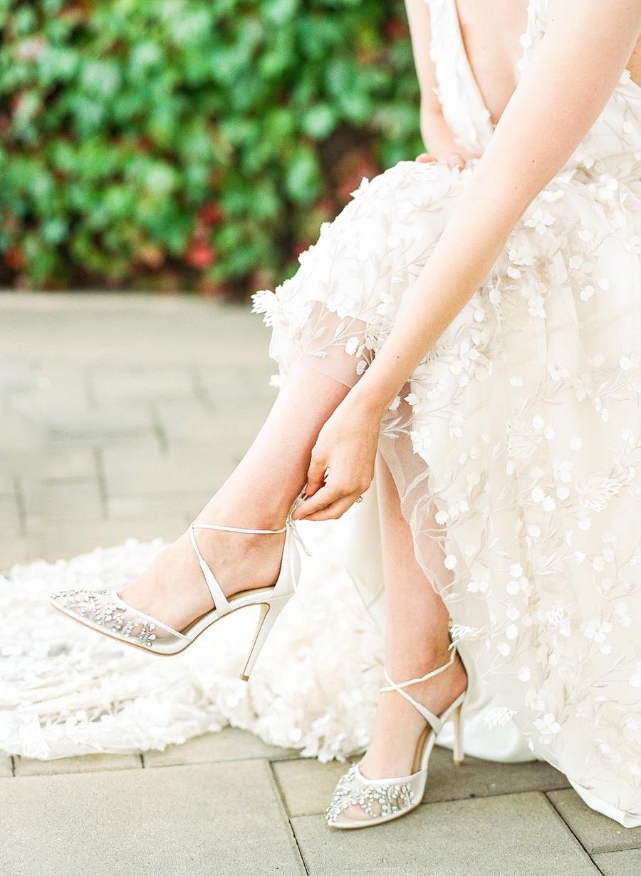 The lace up wedding shoes were embellished and perfectly added a bling to the bridal look
