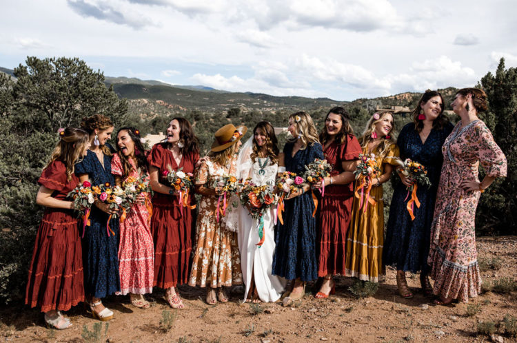 The bride tribe was rocking matching and mismatching bright gowns