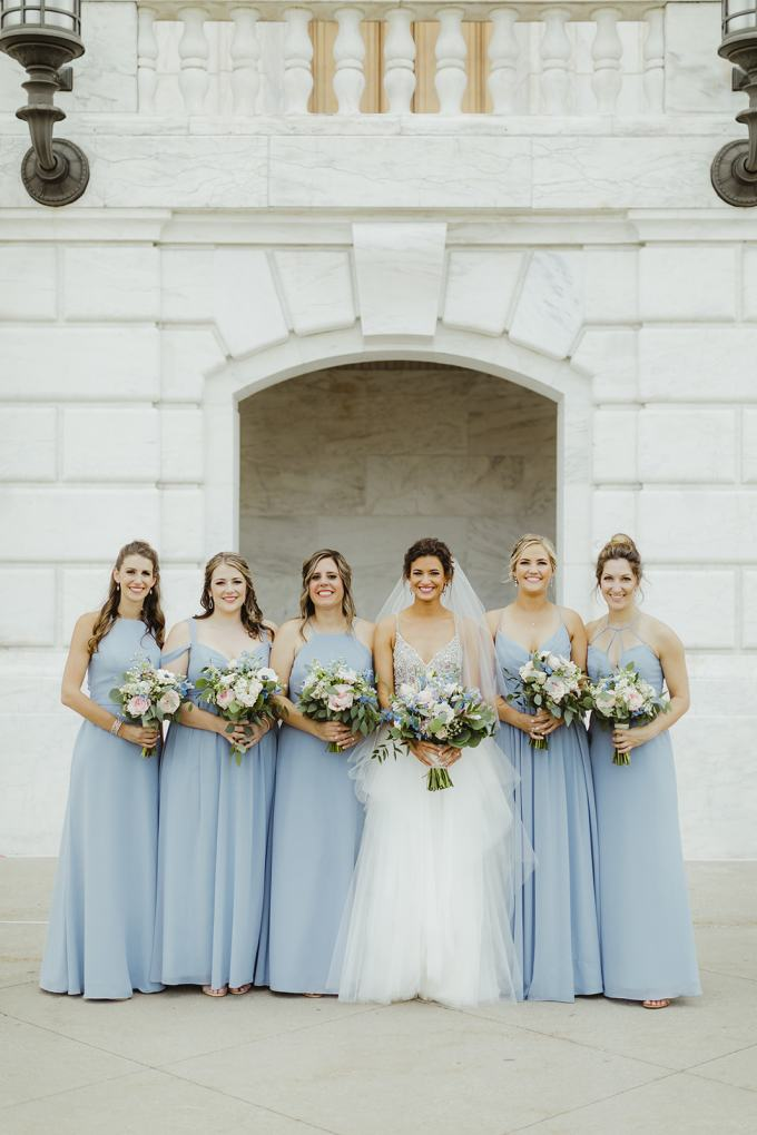 The bridesmaids were wearing mismatching blue maxi dresses
