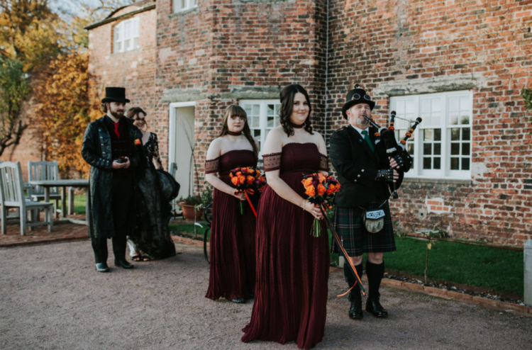 The bridesmaids were wearing off the shoulder burgundy dresses and chokers