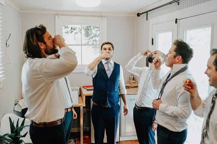The groom was wearing a navy suit with a waistcoat, a white shirt and a light blue tie