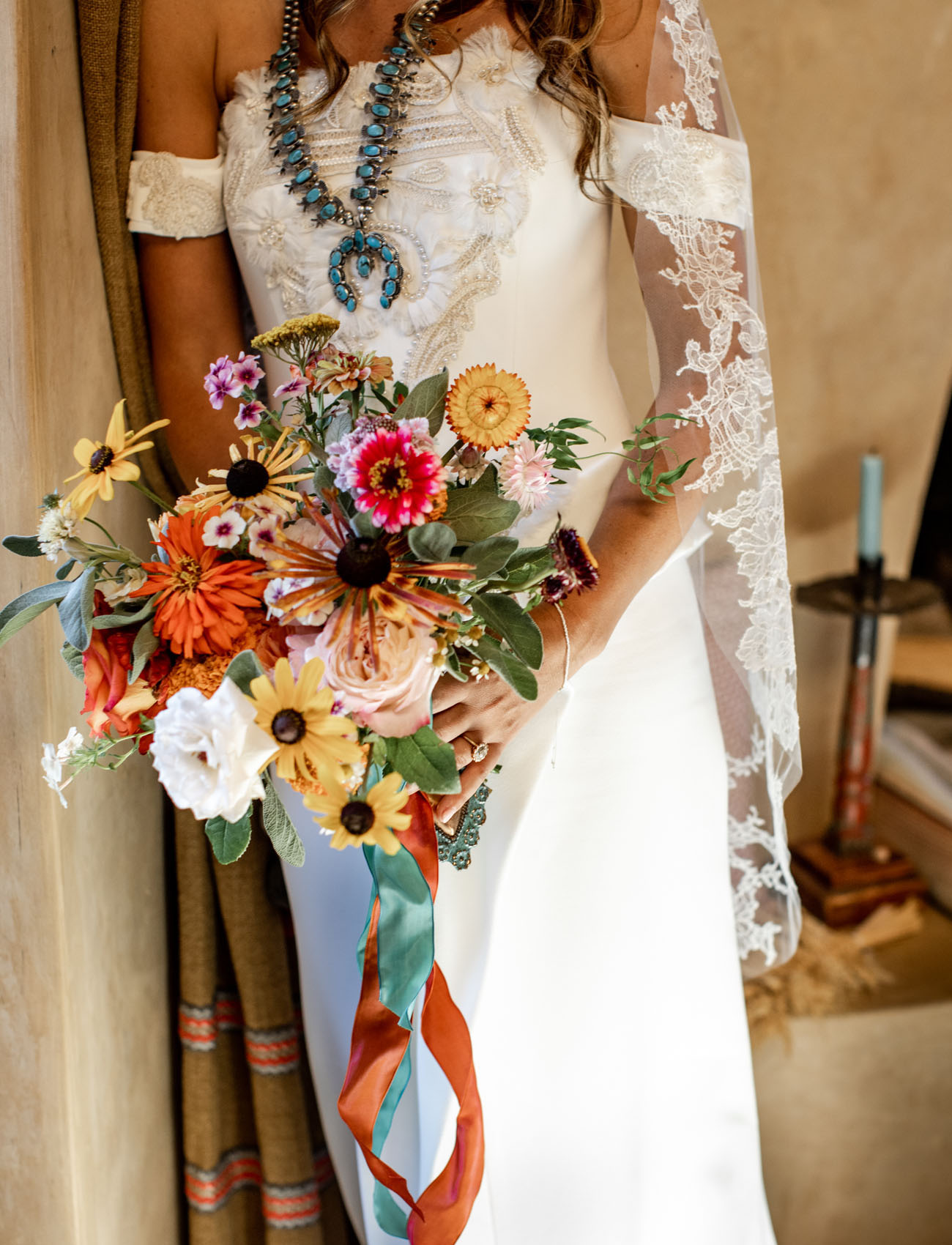 A turquoise necklace and a bright bouquet finished off the bridal look