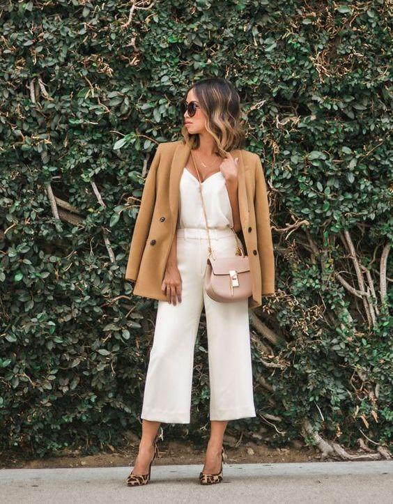 a white silk top, white culottes, animal print shoes, a tan blazer and a blush crossbody bag