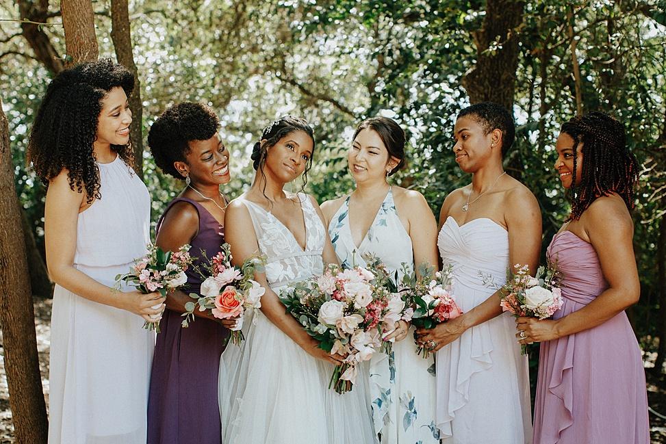 The bridesmaids were rocking mismatching white, mauve, purple and floral maxi dresses
