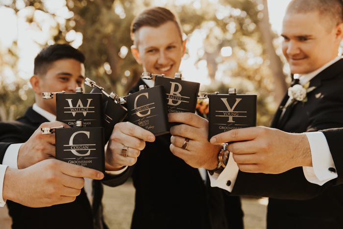 The groomsmen were rocking black tuxes, too