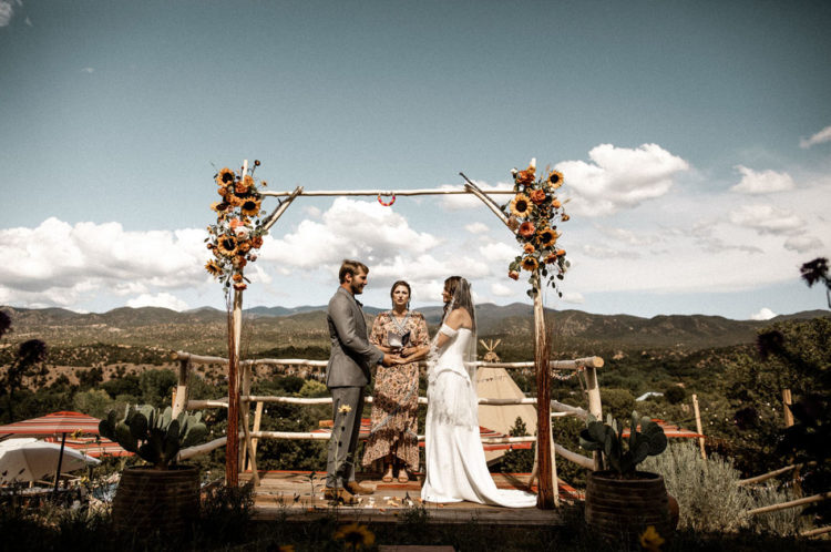 The wedding arch was decorated with sunflowers and greenery and looked rather rustic