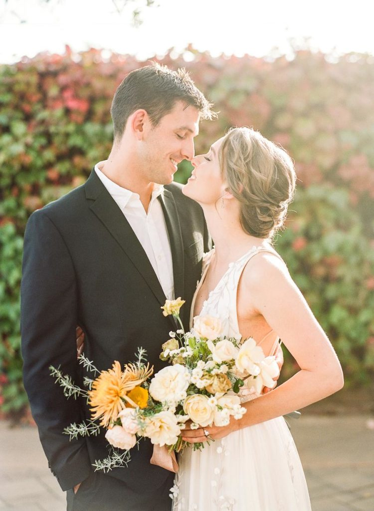 The wedding bouquet was done in neutrals and with sunny yellow blooms and lots of greenery