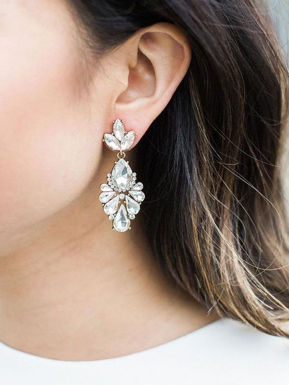 beautiful crystal drop and leaf earrings look statement, vintage like and very chic