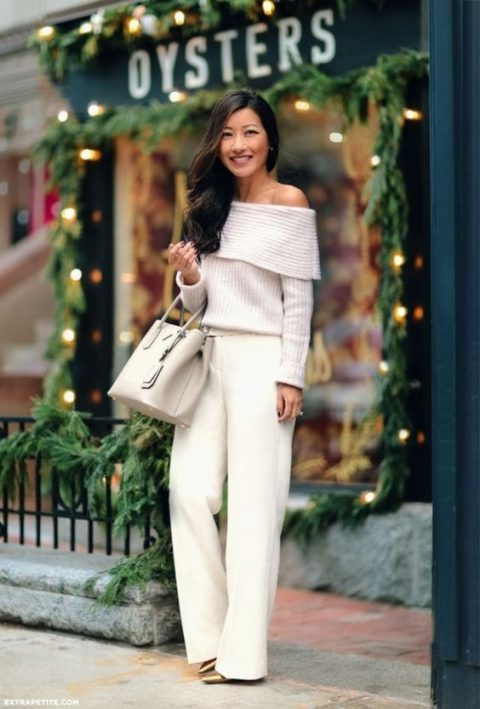 white palazzo pants, an off the shoulder sweater and metallic shoes plus a neutral bag