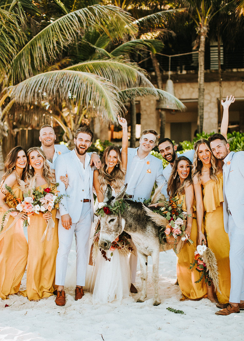 A donkey participated in the wedding, she was dressed up with blooms