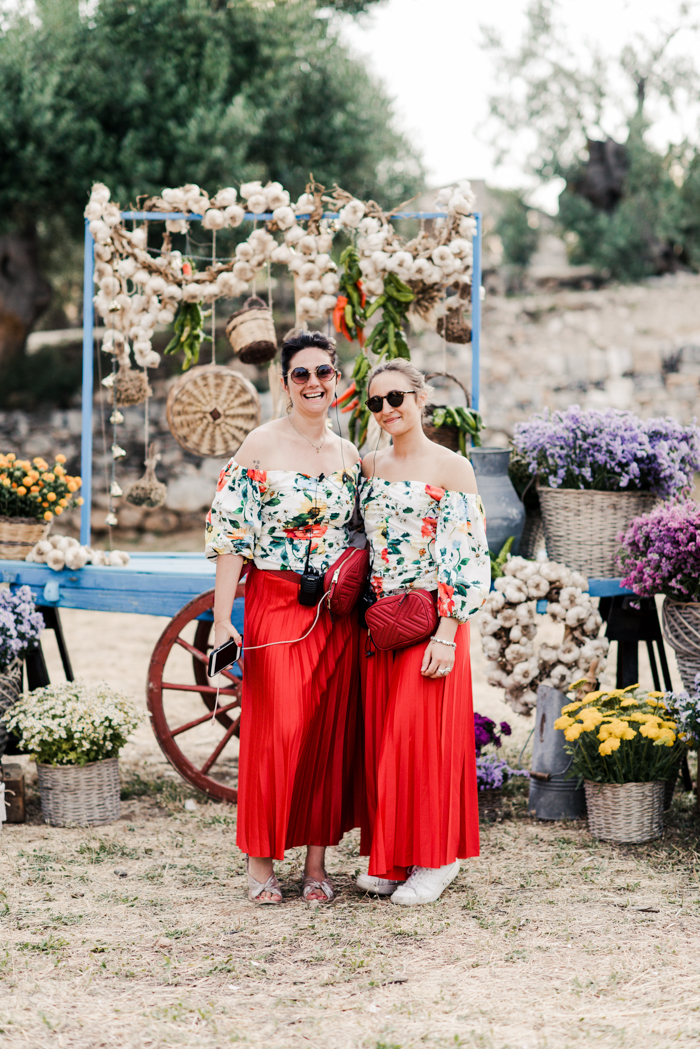 The bridesmaids were wearing bright off the shoulder tops and red pleated maxi skirts