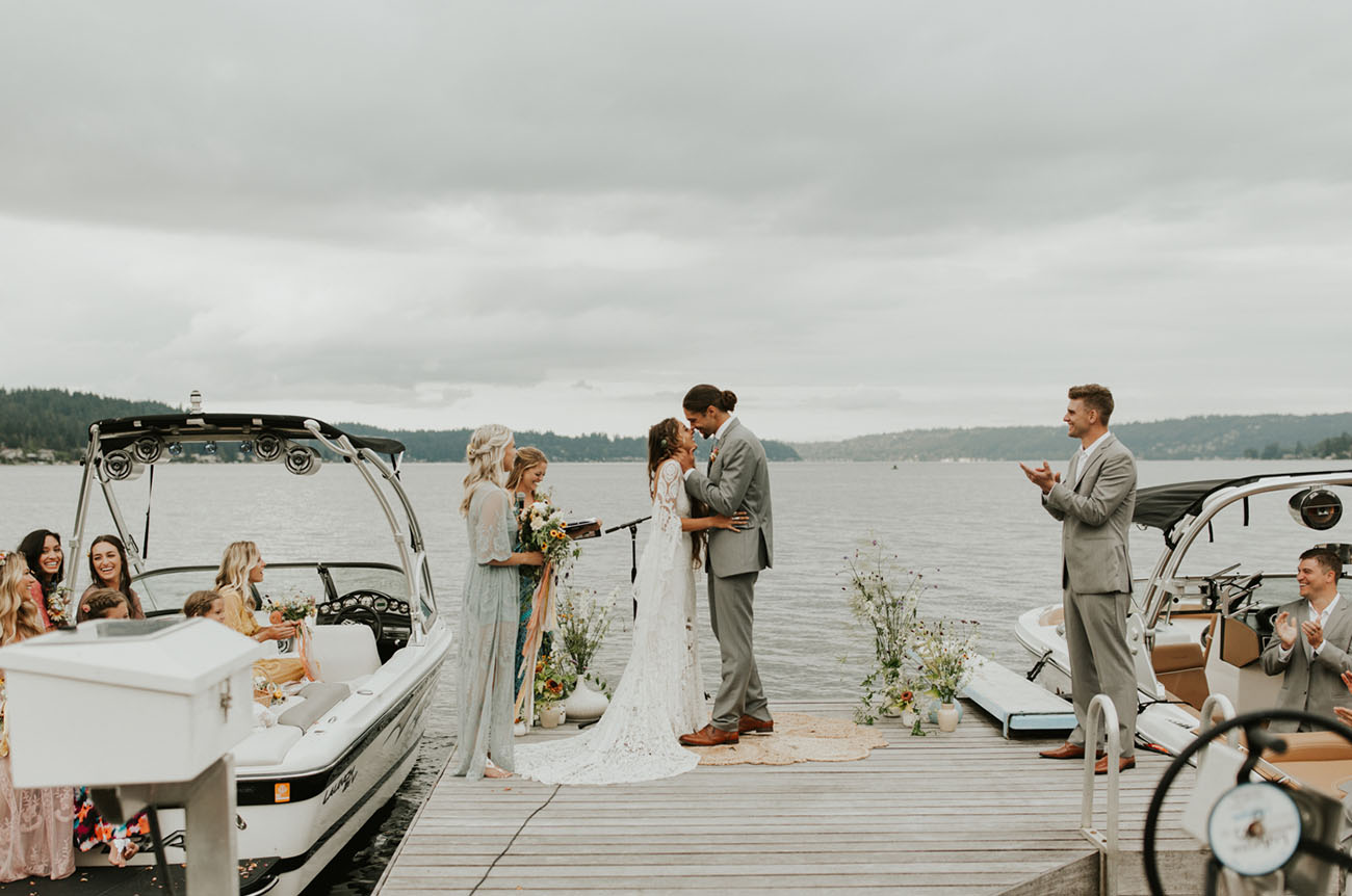 The dock was decorated with boho rugs and widlflower arrangements in vases