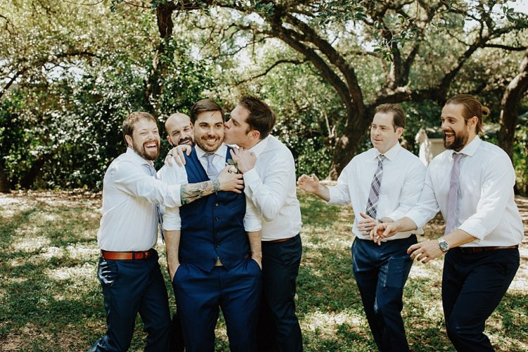 The groomsmen were rocking navy pants, white shirts and printed ties
