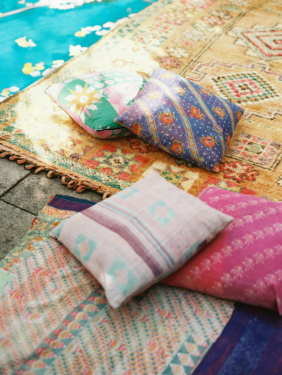 The lounge was styled with colorful rugs and pillows