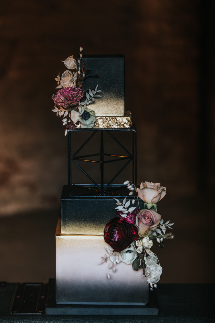 The wedding cake was a white, black and gold glitter one, with bright blooms and greenery