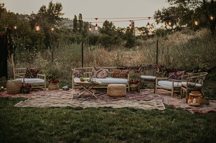 The wedding lounge was done with rattan furniture, boho rugs, candle lanterns