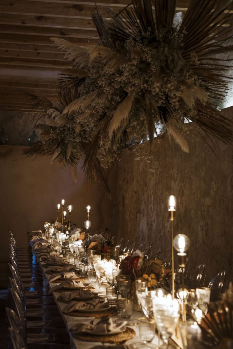 The wedding reception was done with an overhead pampas grass installation and dried touches