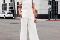 08 a white top with short sleeves, white culottes, blush shoes and a tan bag for a simple bridal shower look
