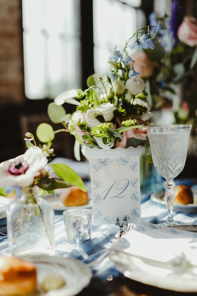 Blue runners and cards refreshed the tablescapes making them more romantic
