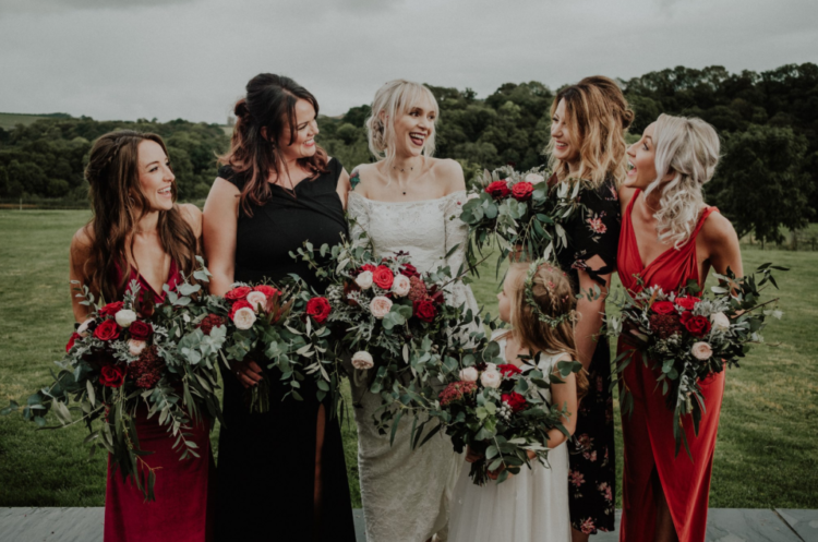 The bridesmaids were wearing mismatching red and black dresses