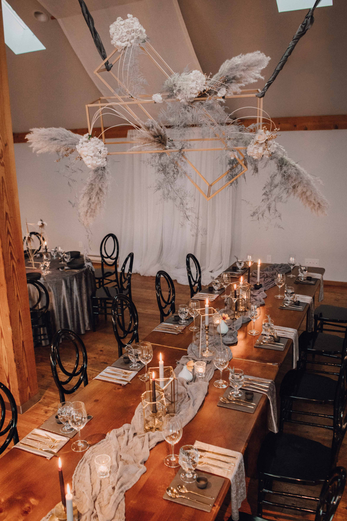 The wedding reception was done with an oversized installation with pampas grass, blush blooms, the wedding tables were styled with runners, candles