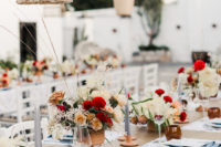 09 The wedding tablescapes were done with bright florals, grey candles and printed placemats