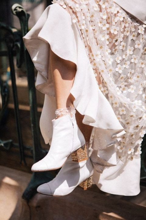 white booties with glitter heels and lace applique socks are a very refined option for a modern bride