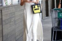 09 white skinnies and a sleeveless midi white dress with side slits, metallic shoes and a two tone bag