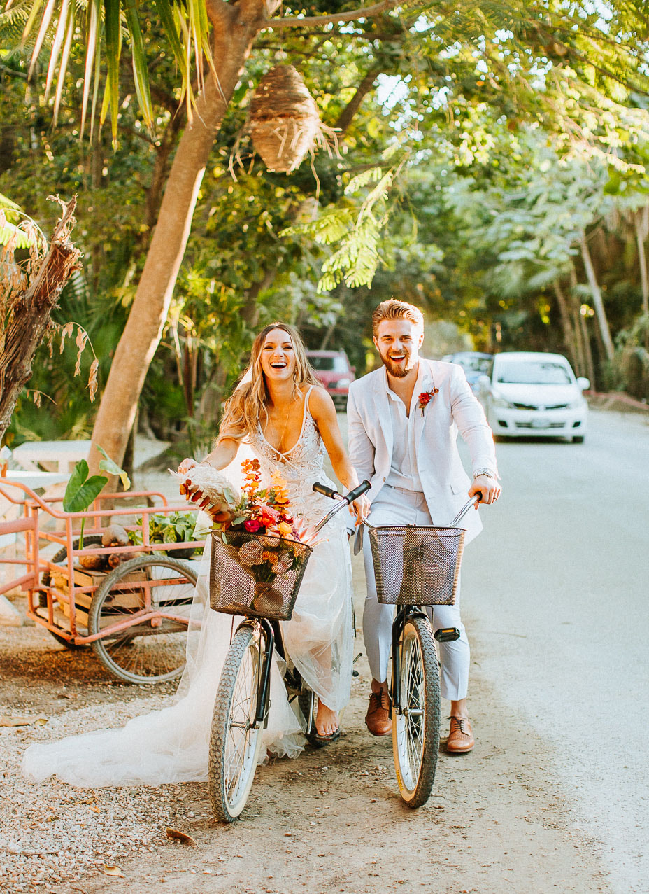 The couple had fun riding bikes for the wedding portraits