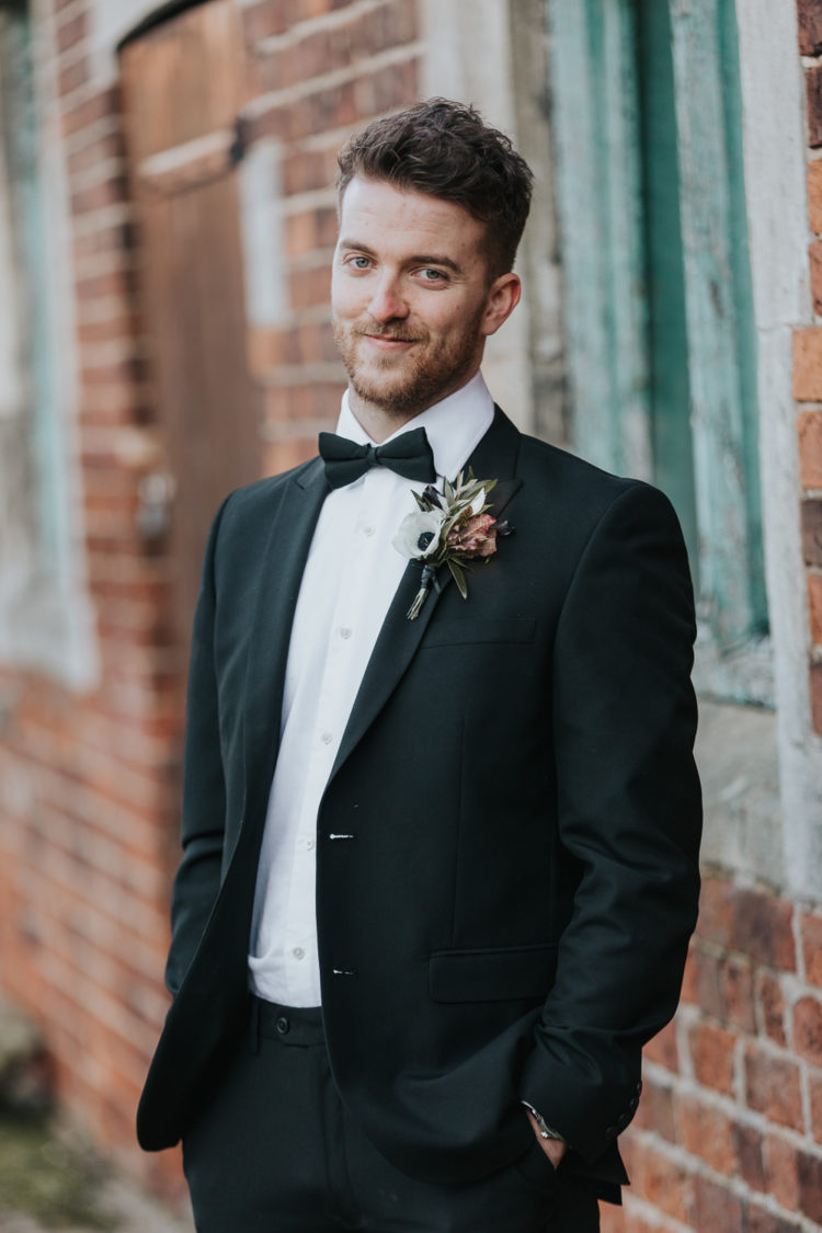 The groom changed up for a classic black tux