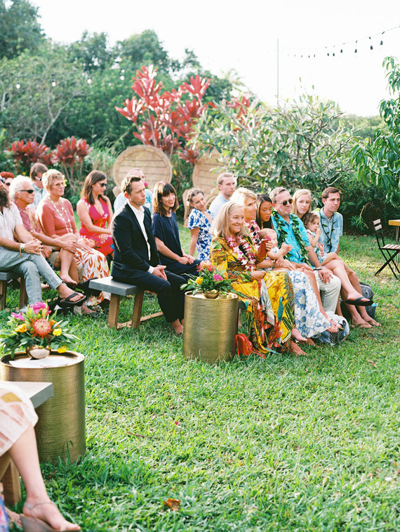 The guests sat on benches outdoors