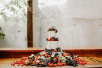 10 The wedding cake was a naked one, with lot sof fruits and berries on top and all around and looked spectacular