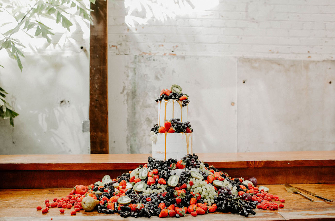 The wedding cake was a naked one, with lot sof fruits and berries on top and all around and looked spectacular
