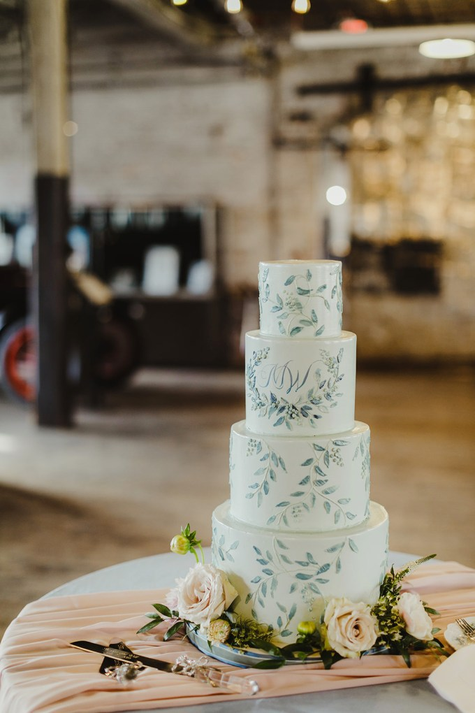 The wedding cake was decorated with blue handpainting and monograms