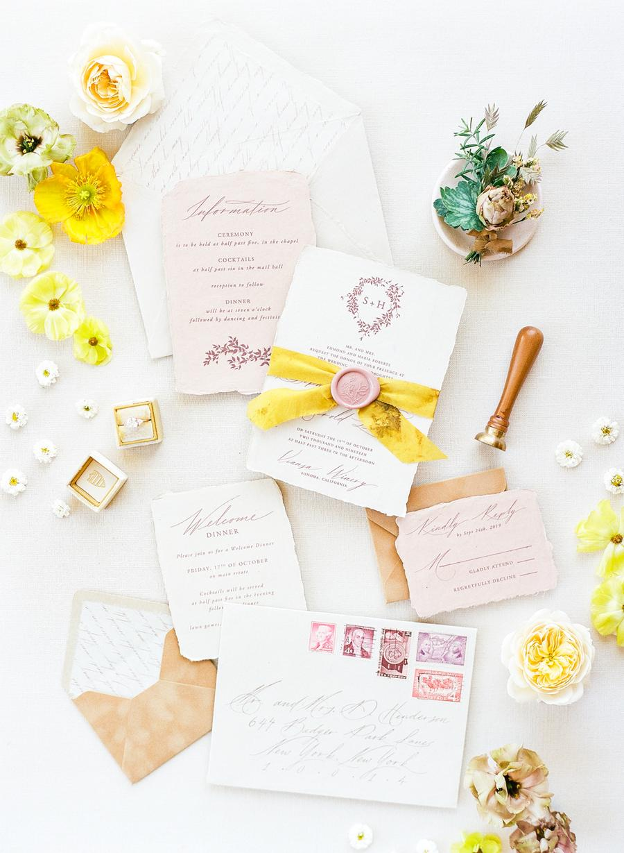 The wedding invitation suite was done with neutrals, blush and seals and bright ribbons