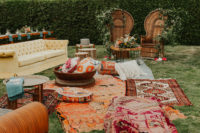 10 The wedding lounge was a truly boho one, with bright rugs, pillows and lots of wildflowers