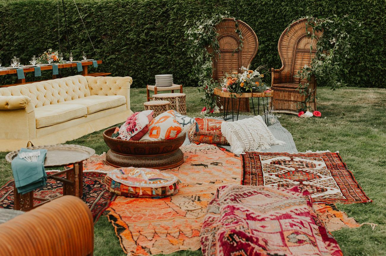 The wedding lounge was a truly boho one, with bright rugs, pillows and lots of wildflowers