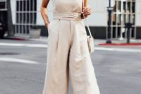 10 an off white jumpsuit with spaghetti straps, wideleg pants, nude shoes and a neutral bag for summer