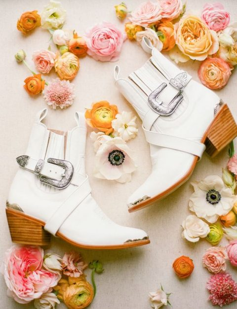 white Chelsea cowboy booties with large silver buckles for a boho touch or a Western wedding