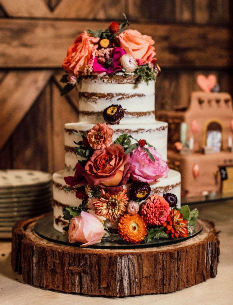 The wedding cake was a naked one decorated with fresh and dried blooms in various colors