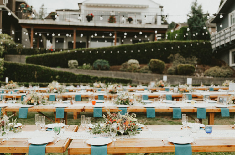 The wedding tables were styled with blue napkins, wildflowers and herbs and greenery