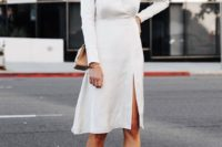 11 a casual knee white dress with a V-neckline, long sleeves, a front slit, nude shoes and a camel bag
