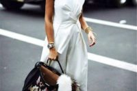 12 a casual white jumpsuit with one cap sleeve, a high neckline, drapery, wideleg pants, white sneakers