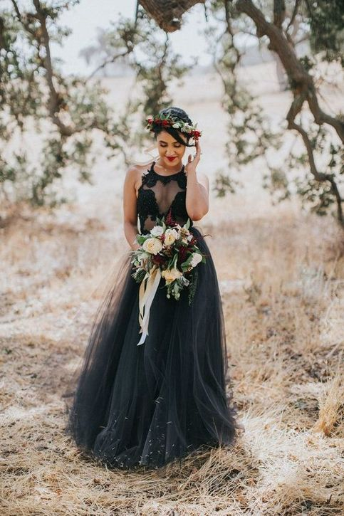 a black lace halter neckline top and a black tulle skirt for a Halloween bridal look
