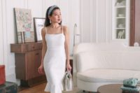 15 a cute white sheath knee dress with spaghetti straps, nude shoes and a white bag for a summer bride