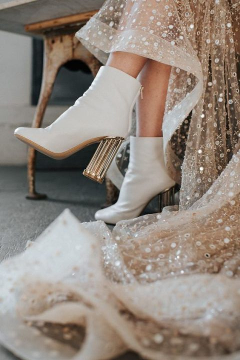 white leather boots with high metallic heels and an embellished wedding dress for a modern glam bride