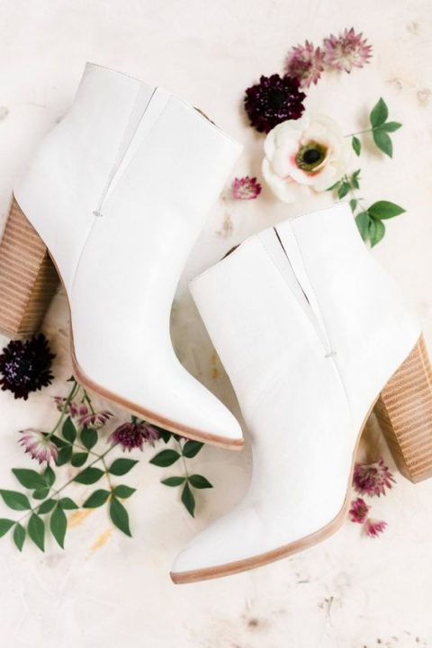 wide white cowboy-inspired boots with high heels are very trendy and can be worn after the wedding