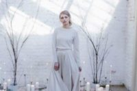 17 a simple A-line pleated maxi skirt, a white top with long sleeves and a high neckline for winter